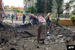 At least 40 people were killed in two car-bomb attacks that Turkey blames on Syrian intelligence.