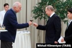 Russian film director Nikita Mikhalkov (left) enjoys a toast with Russian President Vladimir Putin at the Mariinsky Theatre in St. Petersburg in 2016.