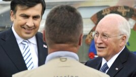 Cheney with Georgia's Mikheil Saakashvili (left) -- future aid will come at a higher price.