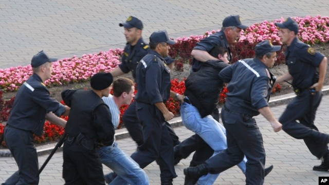 Belarusian policemen detain protesters during a demonstration in Minsk last month.