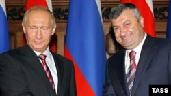 Has Putin (left) lost patience with South Ossetia's Eduard Kokoity?
