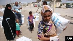نازحون في البصرة يتلقون مساعدات من برنامج الأغذية العالمي - 2 تشرين الأول 2014