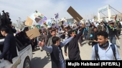 Supporters of Afghan Vice President Abdul Rashid Dostum rally in Mazar-e Sharif.