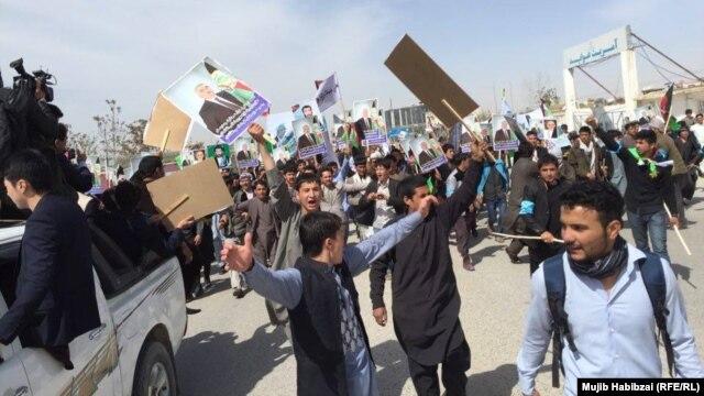 Supporters of Afghan Vice President Abdul Rashid Dostum rally in Mazar-e Sharif.