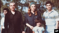 The shah of Iran (left) with his wife and sons Crown Prince Reza on right) and daughter shown during their stay in the Bahamas in April 1979.