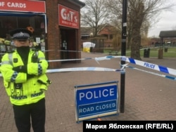 A British policeman guarding the area where former Russian spy Sergei Skripal and his daughter were found unconscious.