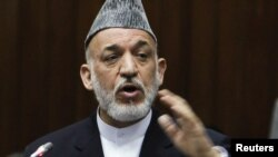 Afghanistan -- President Hamid Karzai speaks during a special session ceremony at the parliament in Kabul, 21Jun2012