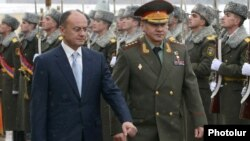 Armenia - Defense Ministers Seyran Ohanian (L) of Armenia and Sergey Shoygu of Russia inspect an Armenian honor guard before talks in Yerevan, 29Jan2013.