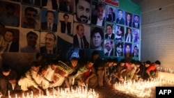 Residents place candles at the site during a vigil to pay tribute to victims a day after a suicide bombing at the Civil Hospital in Quetta on August 9.