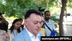 Armenia -- Judge David Grigorian is approached by journalists, Yerevan, July 19, 2019.