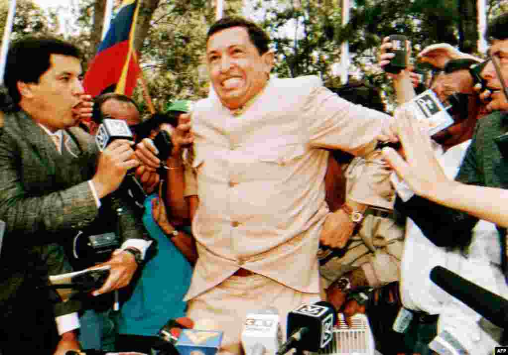 Chavez talks to reporters after being freed from jail on March 26, 1994.