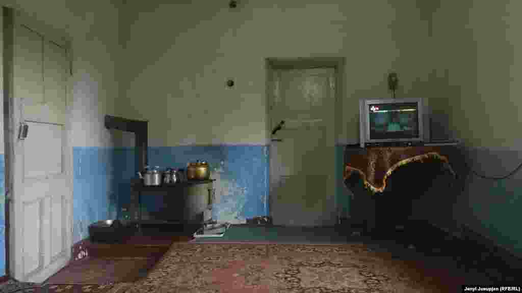 The household of Avaz. Meals are cooked on a stove fire around the year. When electricity is provided in the evening for a few hours, villagers watch satellite TV programs from Uzbekistan and Iran. No video signals reach them from Kyrgyzstan or Tajikistan.