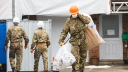 U.K. military personnel at the house of former Russian spy Sergei Skripal in Salisbury, England, on February 4, 2019