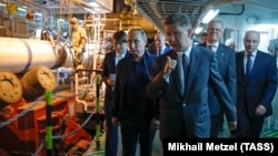 Russian President Vladimir Putin and Gazprom CEO Aleksei Miller inspect work on TurkStream in 2017.