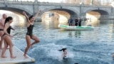 "ITALY -- People called ""Orsi Polari"" (Polar Bears) dive into the icy waters of the Po river in Turin"