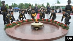 "Kyrgyz soldiers lay a wreath at the ""eternal flame"" monument during WWII Victory Day celebrations in Bishkek last year."