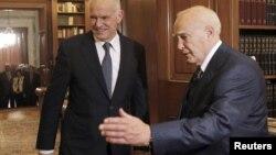 Бывший премьер Георгос Папандреу и президент Греции Каролос Папульяс