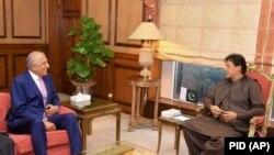 FILE: Pakistani Prime Minister Imran Khan (L) meets with U.S. envoy Zalmay Khalilzad in Islamabad.