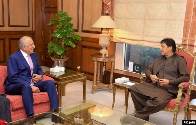 Pakistani Prime Minister Imran Khan (right) meets with U.S. envoy Zalmay Khalilzad in Islamabad on August 1.