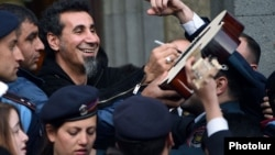 Armenia - U.S.-Armenian rock singer Serj Tankian is mobbed by fans in Yerevan, 25Apr2015.