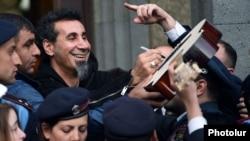 Armenia - U.S.-Armenian rock singer Serj Tankian is mobbed by fans in Yerevan, 25Apr2015.