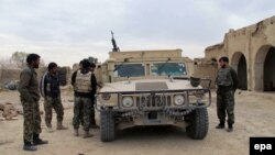 Afghan troops are fighting the Taliban across most of Helmand Province and are in desperate need of reinforcements, officials say.