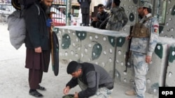 Afghan security officials check a man at Torkham border crossing in March following a previous closure.