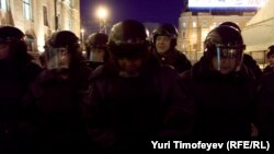 Russian OMON riot-police officers detain an opposition activist in Moscow.