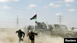 A UN report on the Libya conflict says war crimes have been committed on both sides.