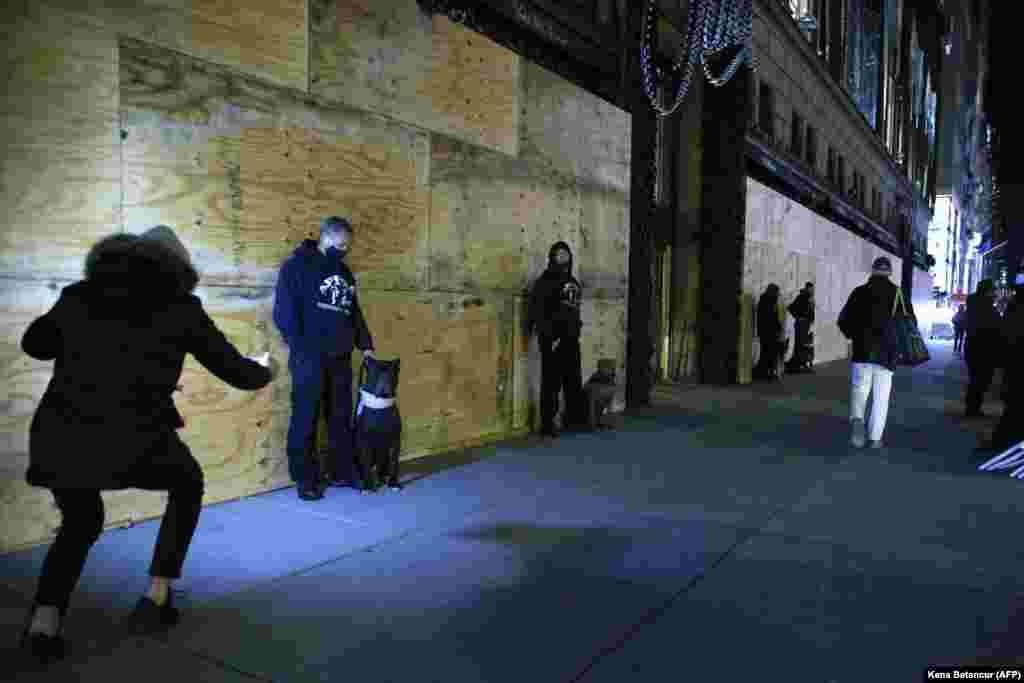 Prive Security Guards stand outside the boarded up Saks Fifth Avenue department store the night before the Presidential Elections in New York, November 2, 2020.