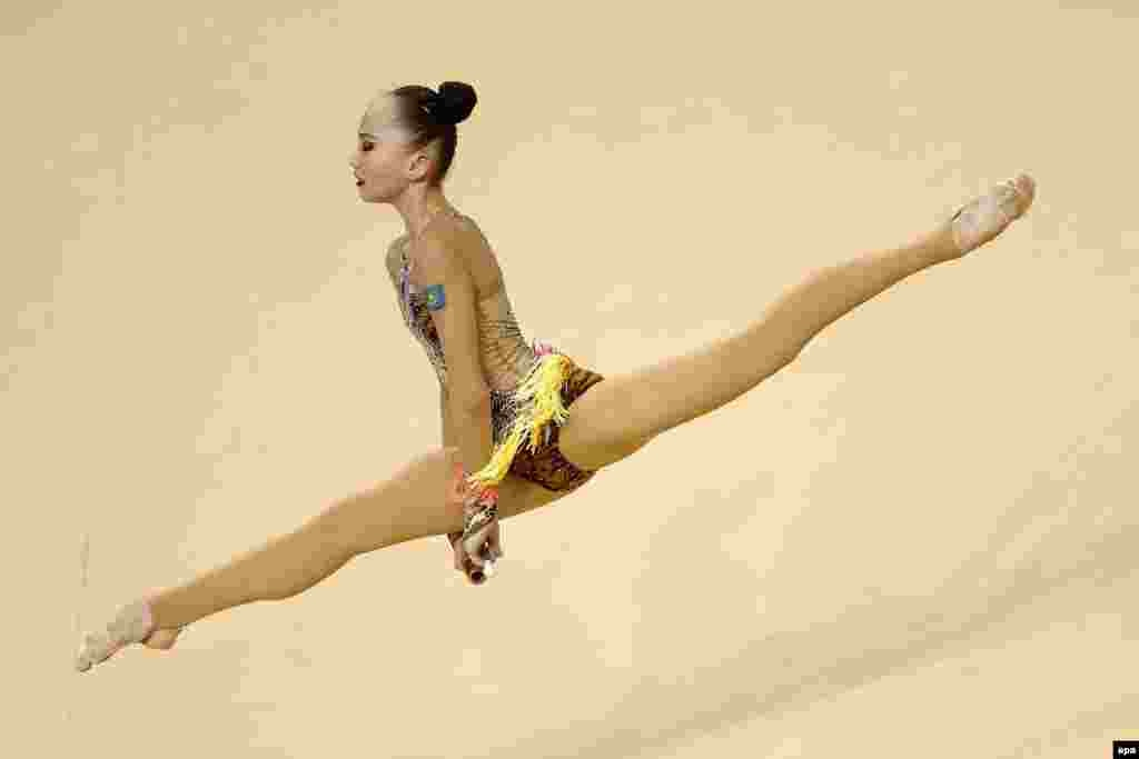 Kazakhstan's Sabina Ashirbaeva participates in the Individual All-Around qualification round of the rhythmic gymnastics test event at the Olympic Arena in Rio de Janeiro. (epa/Marcelo Sayao)