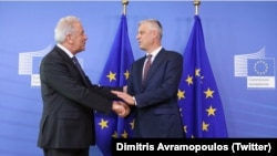 European Commissioner for Home Affairs Dimitris Avramopoulos (left) and Kosovar President Hashim Thaci in Brussels on July 18.
