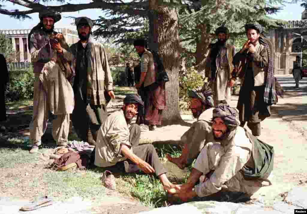 Taliban fighters prepare to pray at Kabul's presidential palace, known as the Arg, in the autumn of 1996. In September, the Islamic militant group captured the city from mujahedin factions who had once fought against the Soviet invasion but by the 1990s were battling each other.