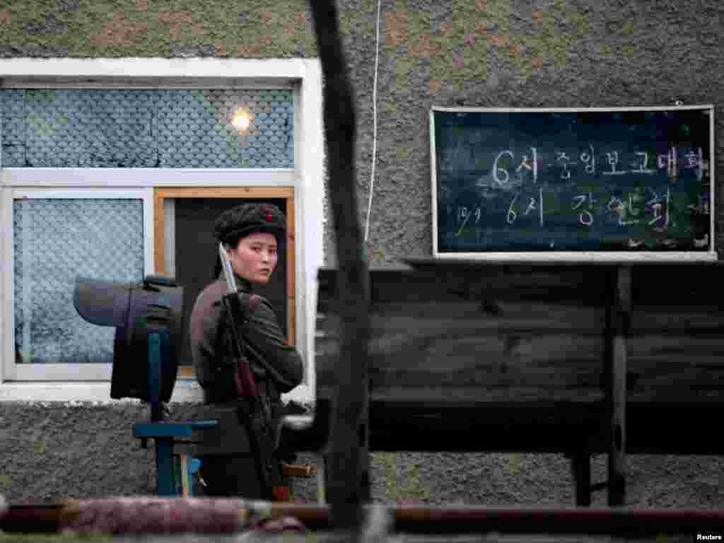 A North Korean soldier guards an army installation on the banks of the Yalu River at the North Korean town of Sinuiju, opposite the Chinese border city of Dandong, October 10, 2006. With world leaders roundly condemning North Korea's announcement it had carried out a nuclear test, U.N. Security Council members weighed an arms embargo and financial sanctions on Pyongyang. REUTERS/Reinhard Krause