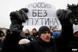 A youthful protester holds a poster reading 'Russia without Putin' as he takes part in an anticorruption rally in St. Petersburg on March 26.