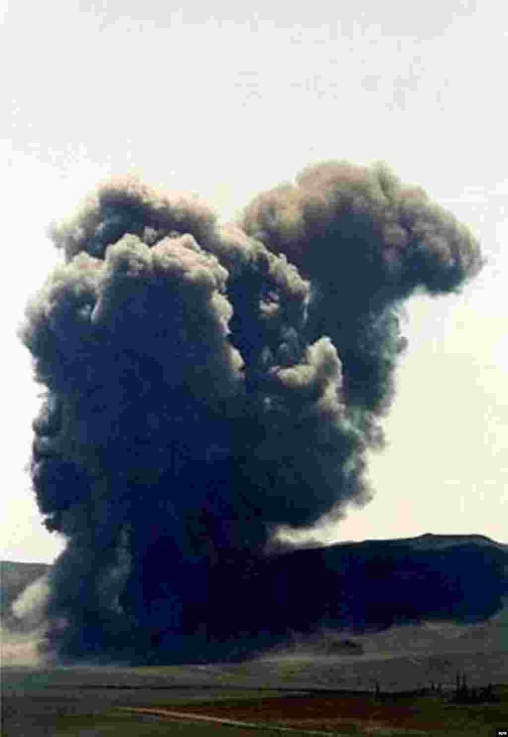 A giant cloud of black smoke arises as Kazakhstan's last nuclear weapons test site is put out of action with a bang in July 2000. The former Soviet republic blew up the sole remaining test tunnel at Semipalatinsk with 90 tons of explosives.