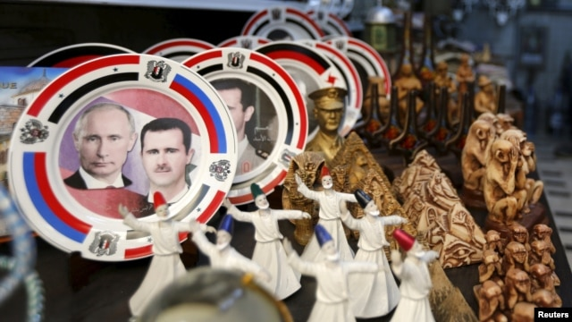 Souvenir plates depicting Syrian President Bashar al-Assad and Russian President Vladimir Putin are seen among other items for sale in old Damascus. How closely the two are coordinating future plans is hard to guess, however.