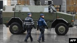 A military vehicle and police in front of the Central Railways station in Brussels on November 21