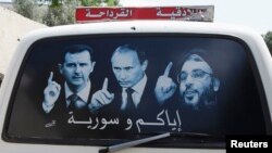"Рисунок на машине, на котором изображены президент Сирии Башар Асад, президент РФ Владимир Путин и лидер ""Хезболлы"" Сайед Насралла. Латакия, Сирия, май 2014 года"