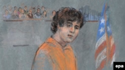 An artist's drawing of Dzhokhar Tsarnaev during his arraignment on 30 federal charges stemming from the events surrounding the Boston Marathon bombing, in the Joseph Moakley Federal Court House in Boston on July 10, 2013.