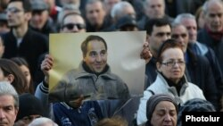 Armenia - A protester holds a picture of Artur Sargsian at a rally in Yerevan, 17Mar2017.