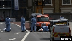 Forensics investigators work on London Bridge after attackers rammed a hired van into pedestrians and stabbed others nearby killing eight and injuring dozens.