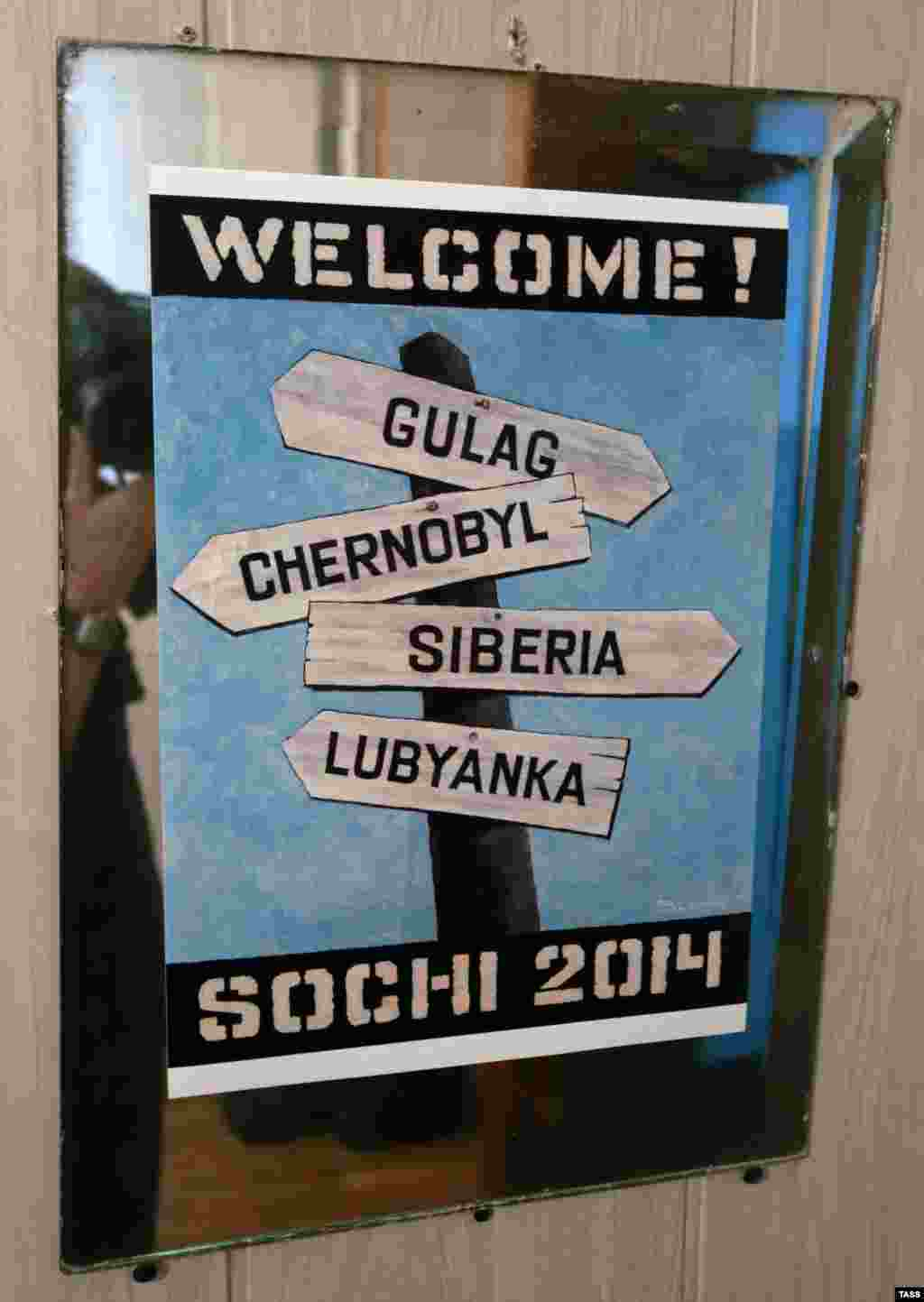 A poster showing road signs directing to Gulag, Chornobyl, Sibir and Lubyanka, the location of Federal Security Service (FSB) headquarters, at Vasily Slonov's Welcome! Sochi-2014 exhibition dedicated to the 22nd Winter Olympic Games, Perm.