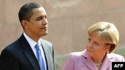German Chancellor Angela Merkel and U.S. President Barack Obama inspect a military honor guard in Baden-Baden on April 3.