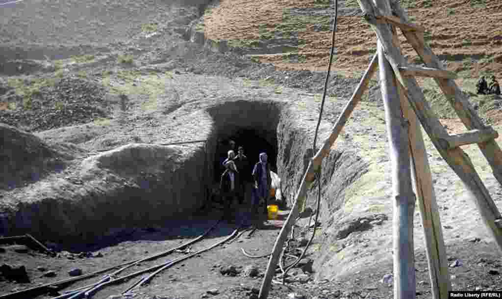 The dead bodies of Afghan miners are brought out of the coal mine.