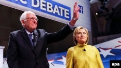 Bernie Sanders (left) acknowledged that Hillary Clinton (right), his rival for the Democratic U.S. presidential nomination, had won the necessary delegates to be their party's choice for the election. (file photo)