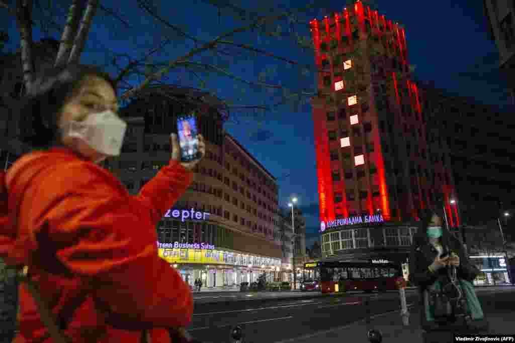 The Palace Albania building in central Belgrade lit up in the colors of the Chinese flag on March 21. Zoric says while some billboards have been rented by government-friendly media, other pro-Chinese displays have been paid for by city authorities.