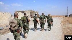 Сирия провинциясы Алепподағы үкімет әскерилері. Көрнекі сурет.