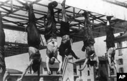 მუსოლინისა და მისი თანხმლები პირების გვამები. მილანი, 1945 წლის 28-29 აპრილი