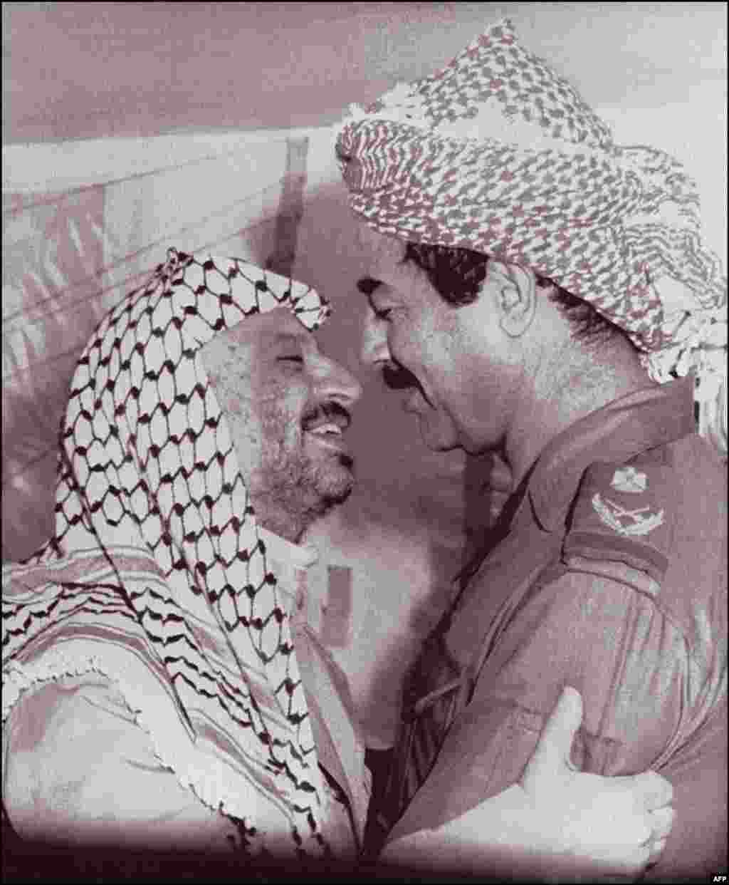 With Palestinian leader Yasser Arafat in 1980. Although Saddam Hussein was popular with some in the Arab world through the 1970s, Arafat would be one of the few global figures to support him during the first Gulf War in 1991.